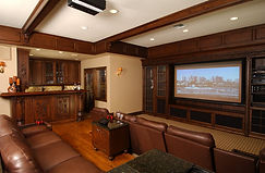 contemporary style media room in beautiful finished basement