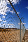 Tall Chain Link Fence with barbed wire top