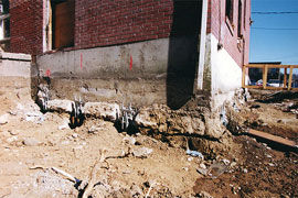 crumbling foundation of a commercial building