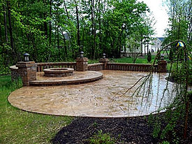 Stunning stamped concrete patio with fire pit