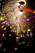 DJ sillouhette with light hitting mirror ball