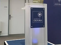 Acylic lectern being used at an Oxford university presentation