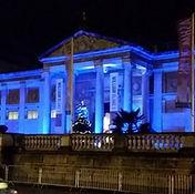 Ashmolean exterior lit up blue