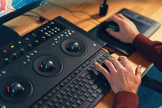 video-editor-hands-adjusting-color-or-so