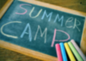 text summer camp written with chalk on a