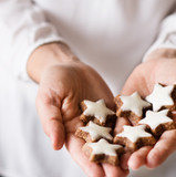 young-woman-holding-star-shaped-christma