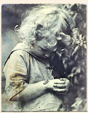 little girl with caterpillar