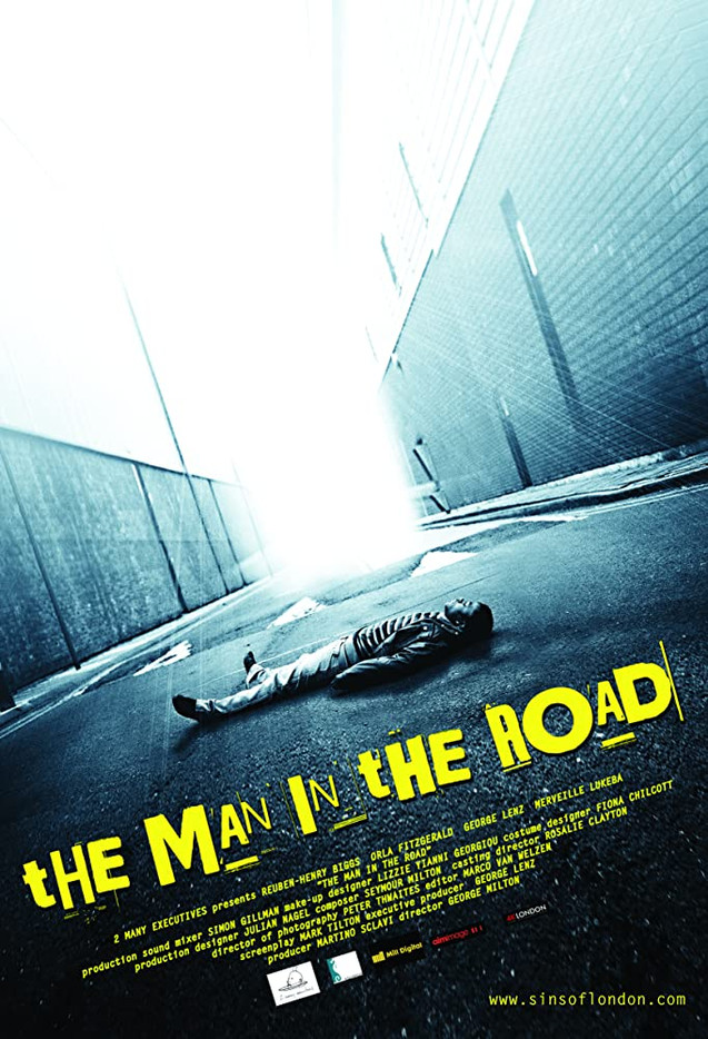 THE MAN IN THE ROAD