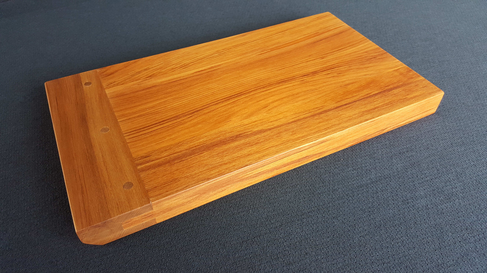 An OB Rimu platter with angled breadboard end. Size 362L x 195W x 27 (mm) Currently available $120