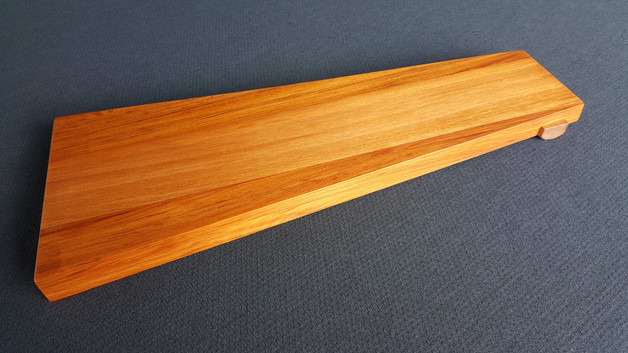 Despite appearances, this double wedge shaped platter of rimu and kauri is flat across the top so your food won't roll off the end!! A great sharing platter for a narrower table setting. Size 465L x 182/98W x 27 (mm) Currently available $145