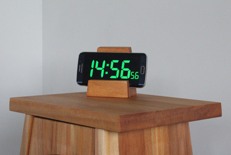 bedside table with alarm.JPG