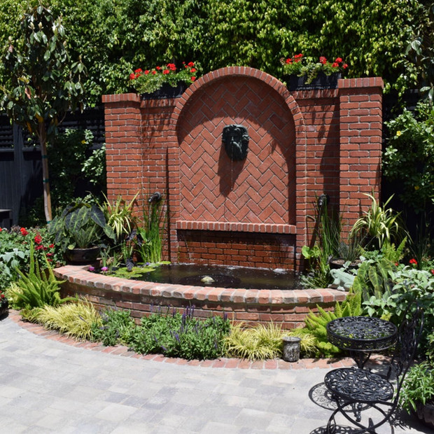 Custom Water Feature, Koi pond and planters. Fully automated, chemical free water treatment.