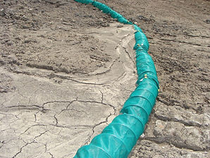 BMP's Spring Berm is an expanding energy dissipater that reduces run-off and prevents the formation of rills or gully's in channels or highway ditches.