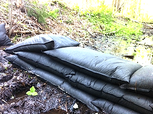 BMP manufactures sandless sandbags that can fully expand absorbing 4 gallons of water in 5 minutes. They convert from 0.8 lbs dry to 34 lbs expanded.