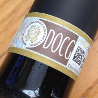 The DOCG label , one of the ways you can recognize Italian high quality wine is from this label that has yellow borders and the initials D O C G , D O C G stands for  certified quality wine controlled by  geographical origin