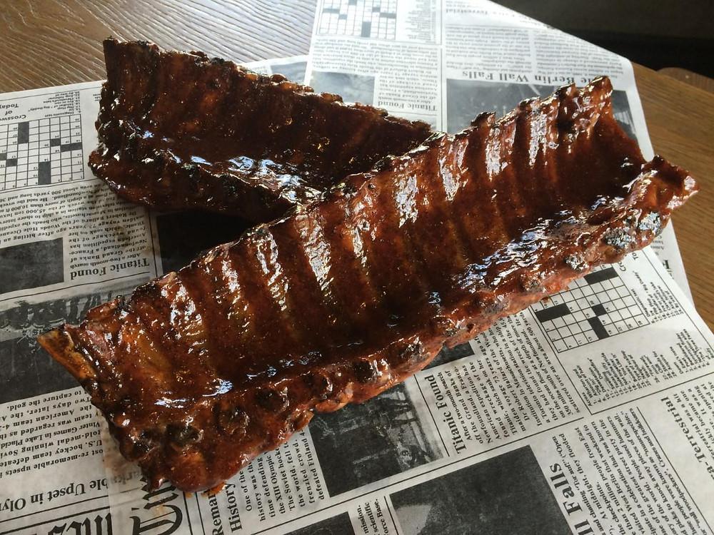 Rack of ribs on newspaper