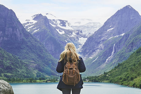 Adventure backpacking woman enjoying vie