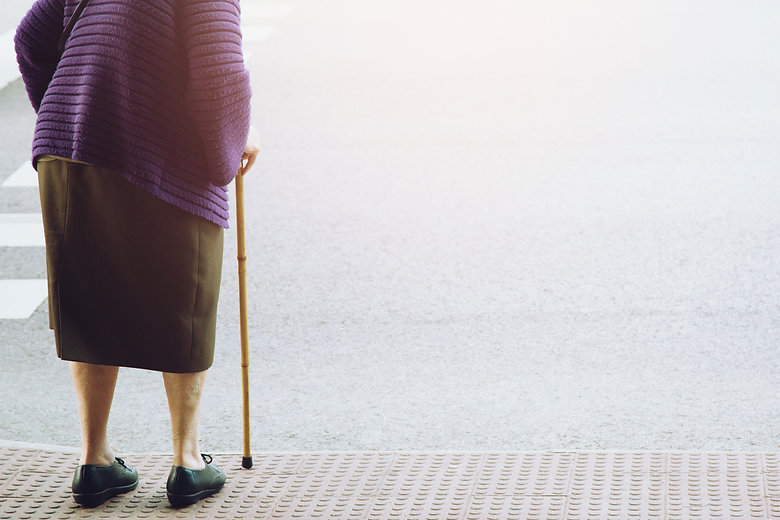 elderly old woman with walking stick sta