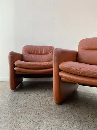 70's pair of leather armchairs