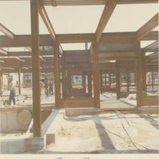 The exposed steel structure is seen on the inside and outside of the library.