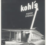 The large enamel blade sign at the Kohl's Food store on North Avenue in Wauwatosa illuminated at night. Courtesy of the Milwaukee County Historical Society.