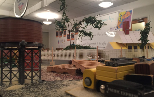 """For more authenticity, students added sand and painted two miniature wooden pallets to the """"old train yard."""""""