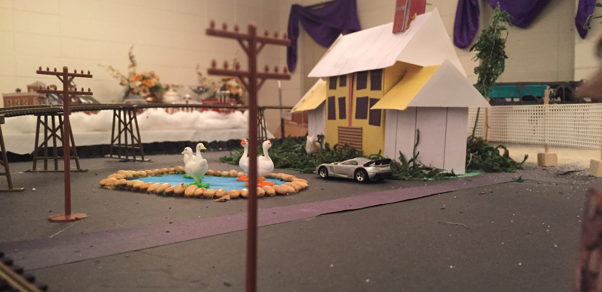 Added ducks and swans to the farmhouse pond. Also, the farmhouse owner has a Lamborgini.