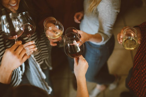 several-people-holding-wine-glasses-make-a-toast