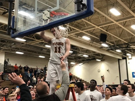 Vikings' guard Justin Jaworski cuts down the net following Perkiomen Valley's 52-45 victory in PAC Championship Photo Credit @raydunne21 Photography