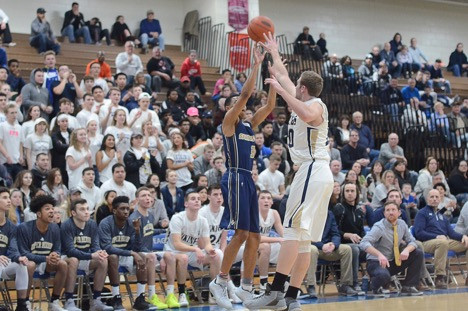Spring-Ford's Chucky Drummond rises up for a three over Upper Merion's Ethan Miller (20). (Sam Stewart - Digital First Media)
