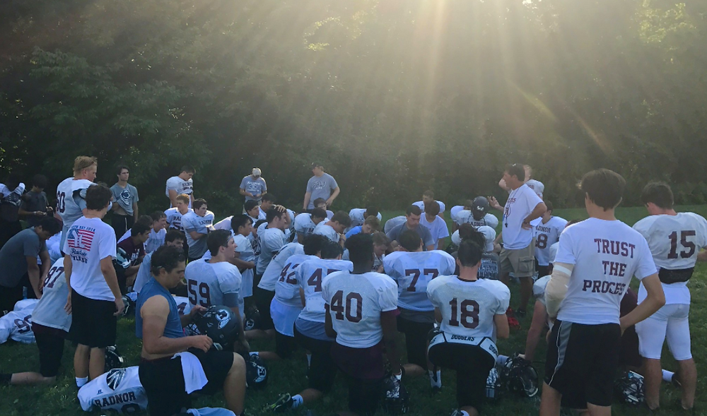 Coach Tom Ryan talking to his players during a Radnor football summer camp session - Photo Credit - @RadnorFootball Twitter