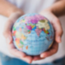 close-up-of-hand-holding-globe_23-214781