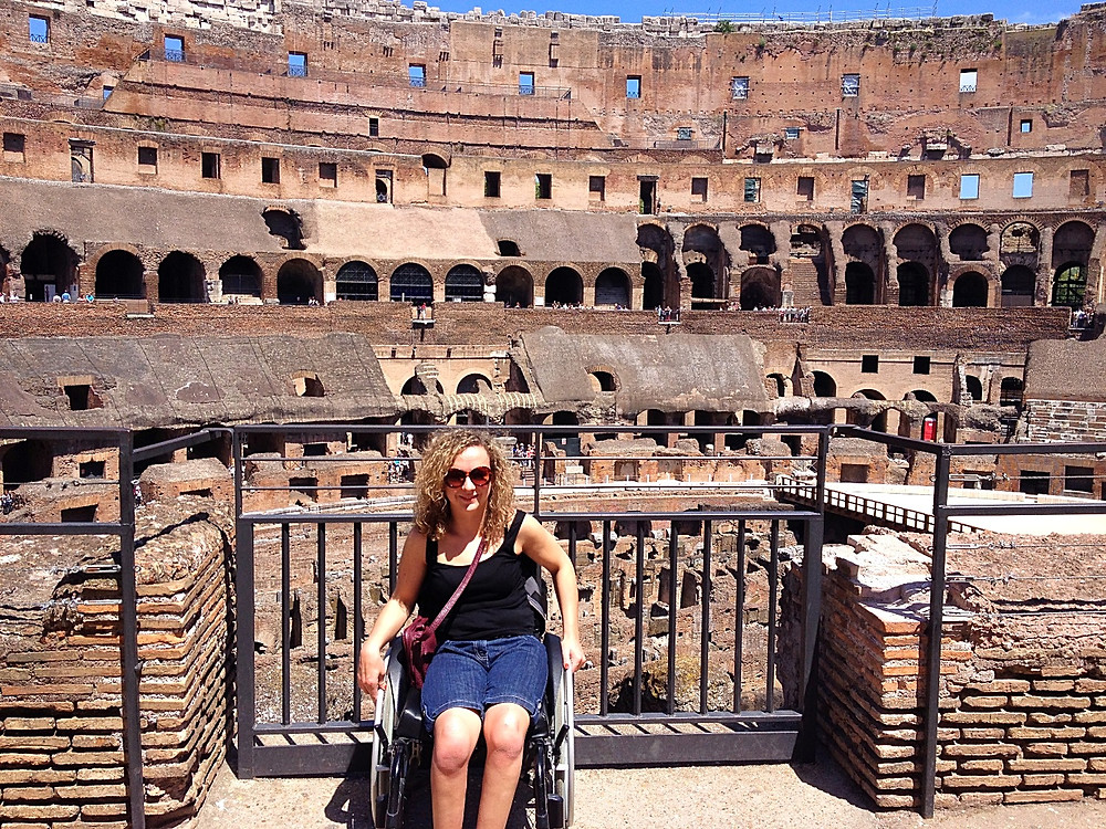Carrie-Ann Lightley disabled travel blogger at Rome's Colosseum