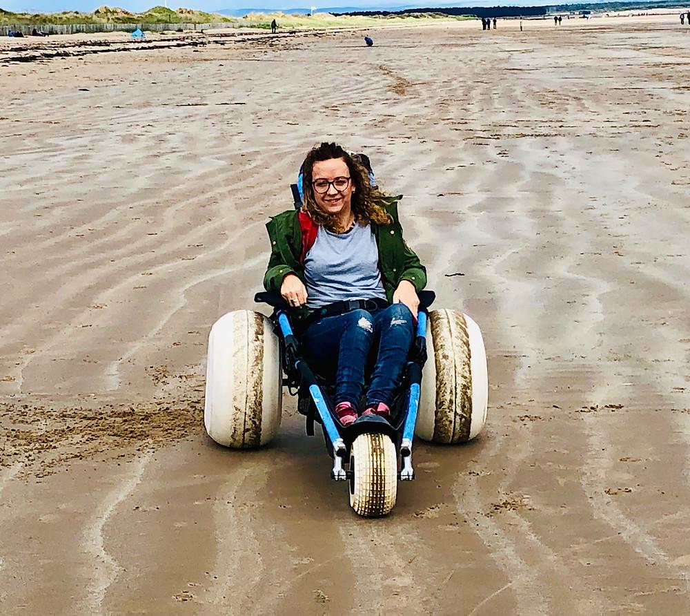 Carrie-Ann using a beach wheelchair