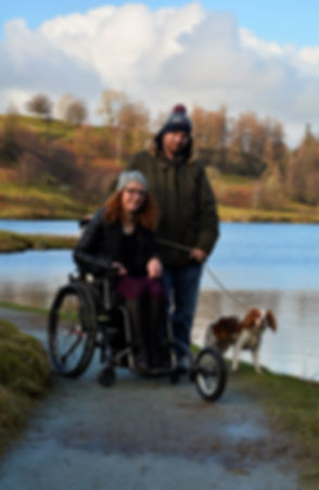 Carrie-Ann, her husband Darren and her dog Poppy in the Lake District countryside