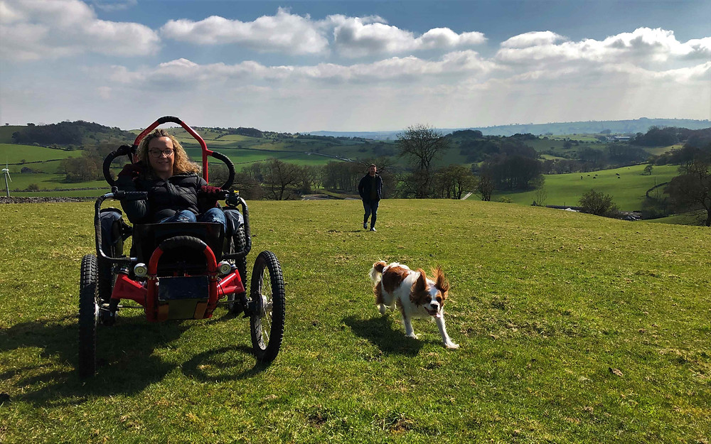 Carrie-Ann using an all terrain wheelchair in farm fields