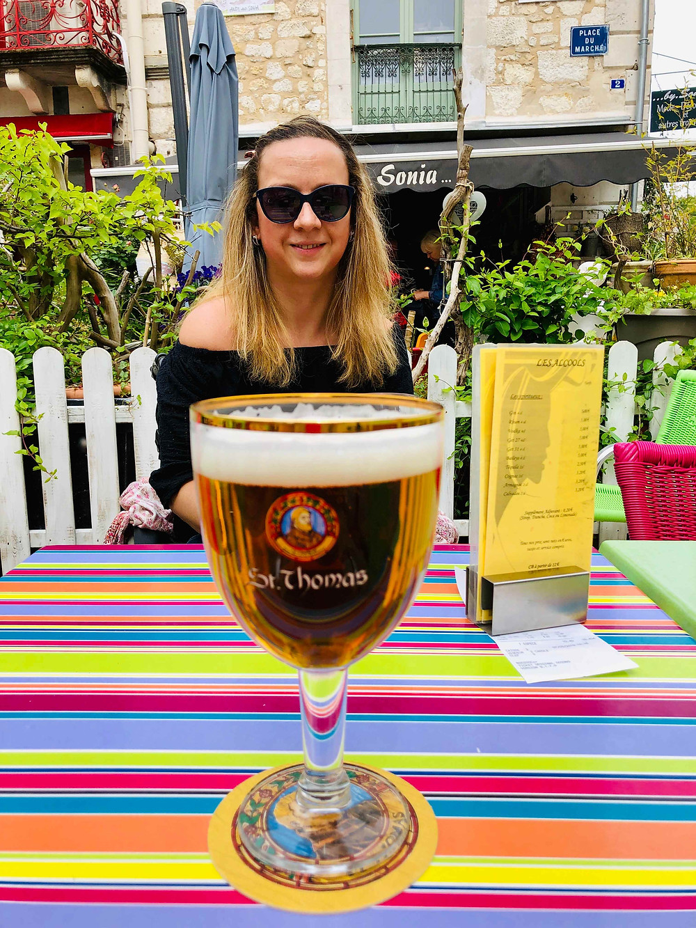 Carrie-Ann Lightley Disabled Travel Blogger drinking beer in Brantome