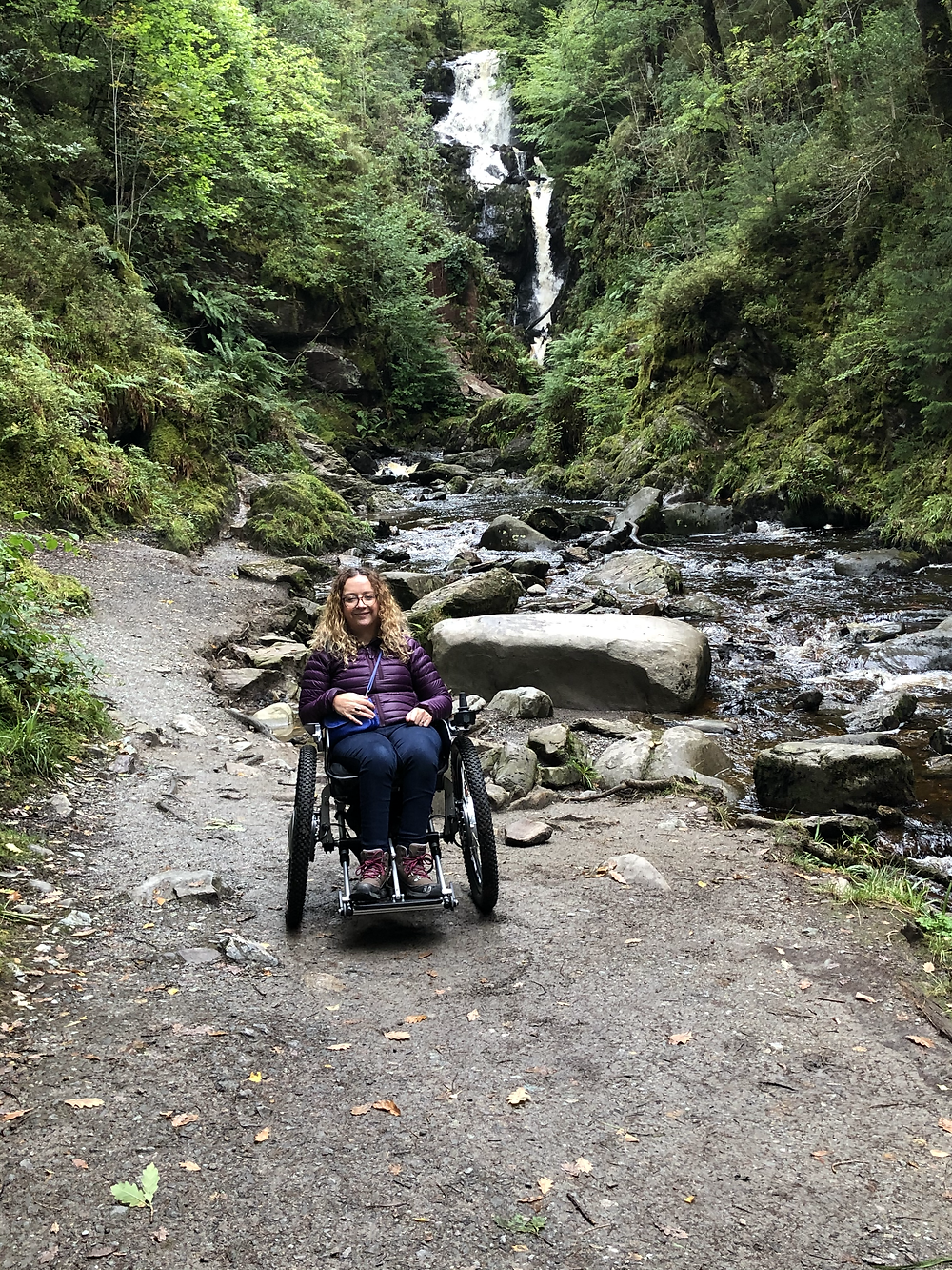 Carrie-Ann in her wheelchair on the Queen Elizabeth Forest Park Waterfall Trail