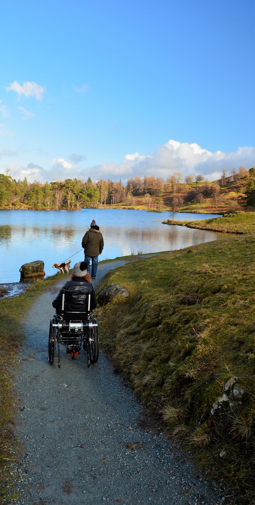 Carrie-Ann Lightley disabled travel blogger enjoying an accessible wheel around Tarn Hows, Coniston, Lake District, UK