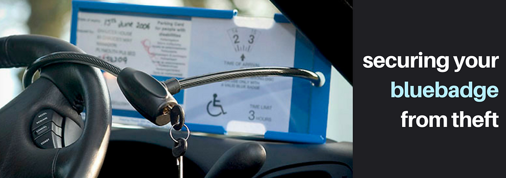 Blue badge protector locked to steering wheel with cable