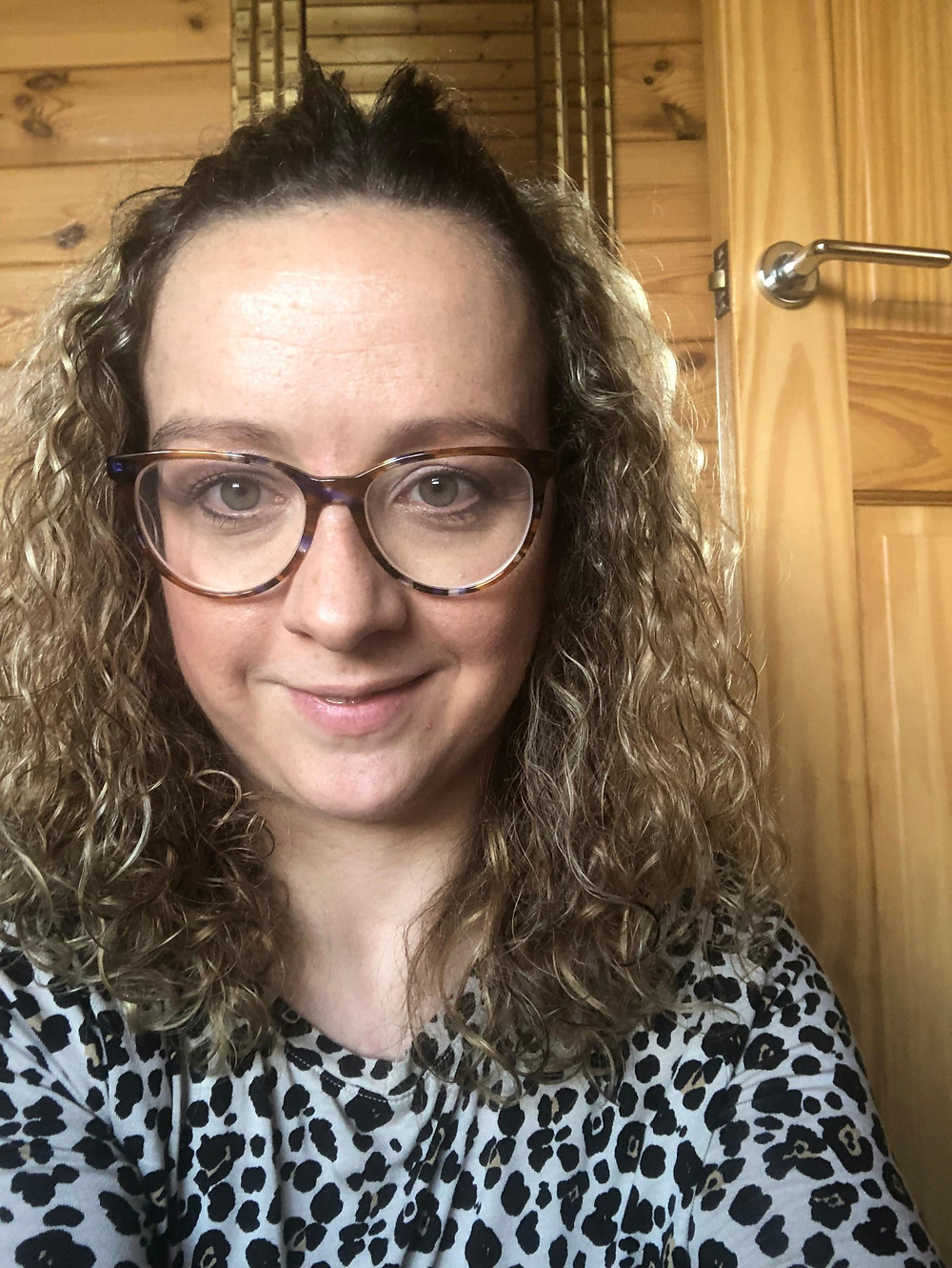 Carrie-Ann Lightley Disabled Travel Blogger wearing her glasses and a leopard print top
