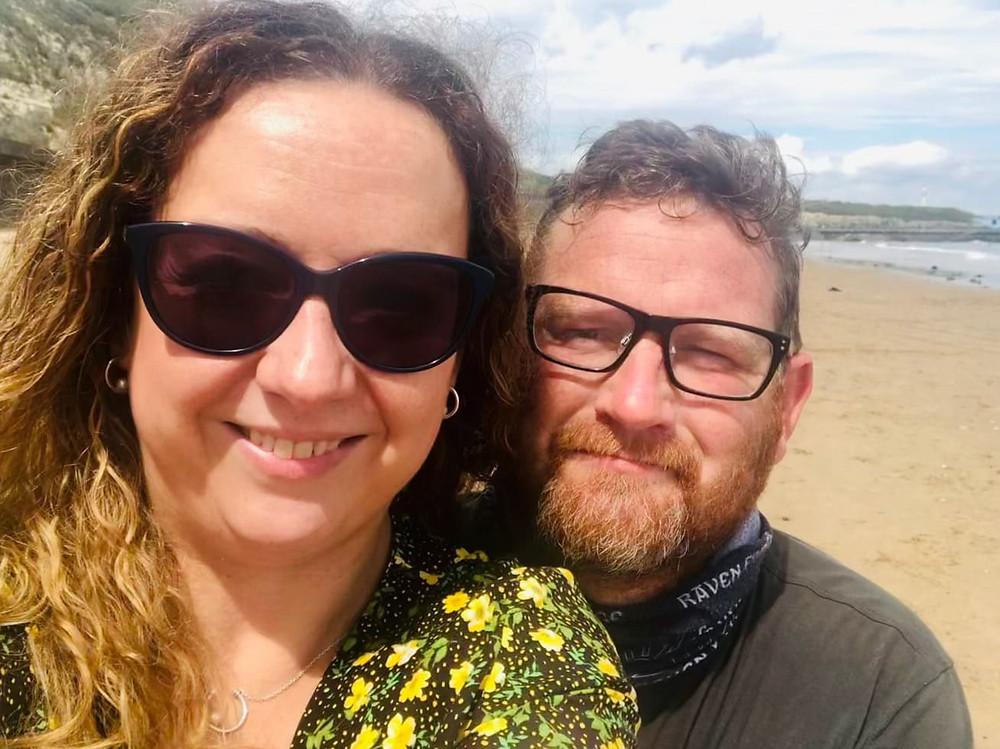Carrie-Ann and her husband Darren smiling on Seaburn Beach Sunderland