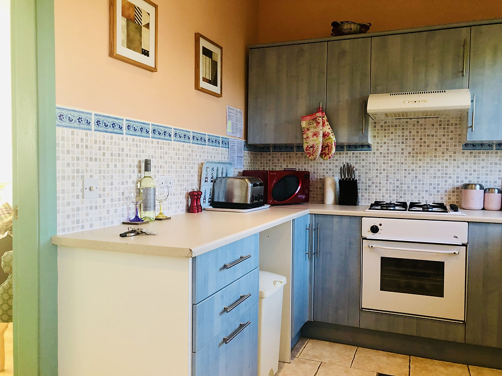 Quarters Lancaster Kitchen with pale blue units and a white oven