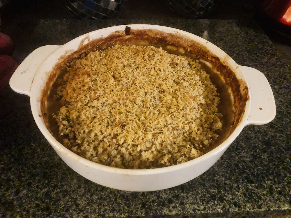 Pie dish filled with chicken and vegetable crumble