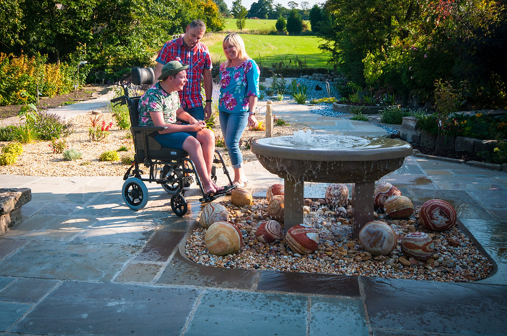 Family in Croft Bungalow's wheelchair accessible garden