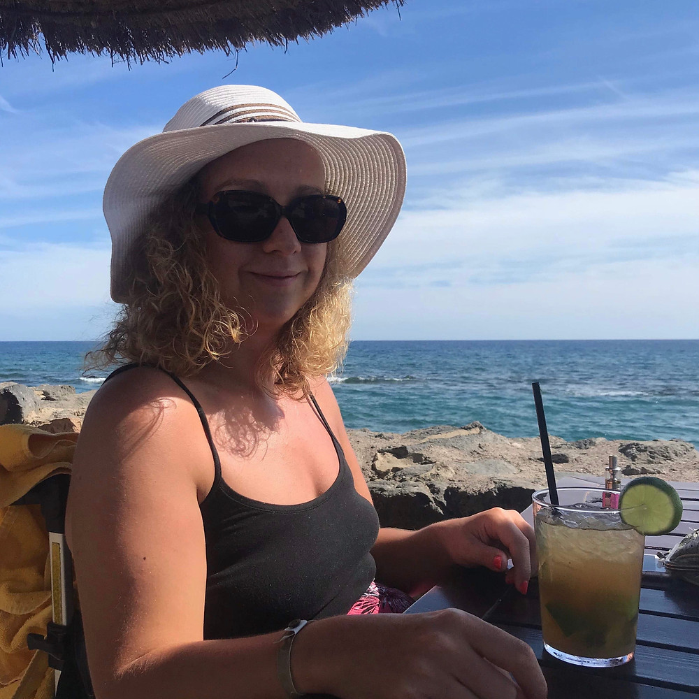 Carrie-Ann Lightley Disabled Travel Blogger on holiday in Fuerteventura by the sea