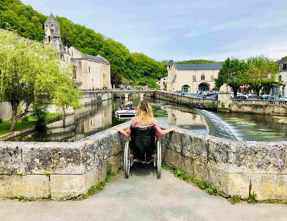 Carrie-Ann Lightley Disabled Travel Blogger overlooking the river in Brantome