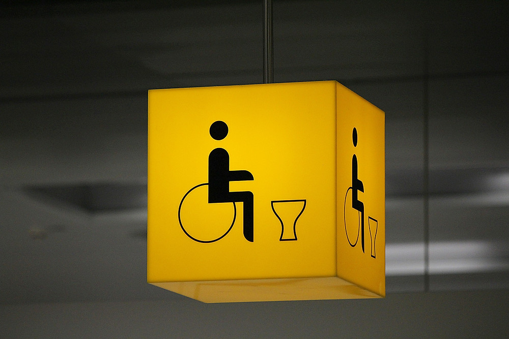 Airport accessible toilet signage