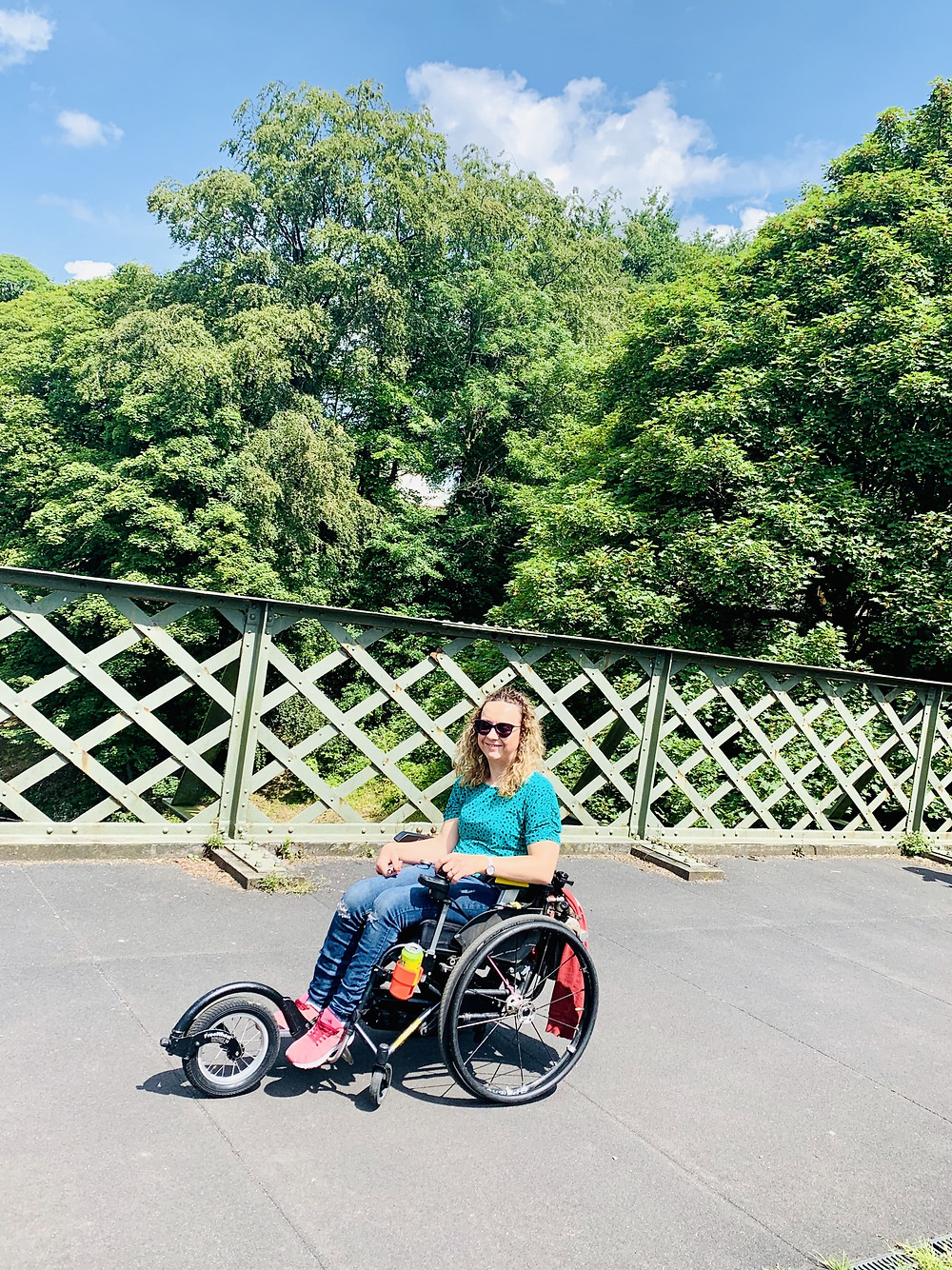 Carrie-Ann in her wheelchair on a bridge