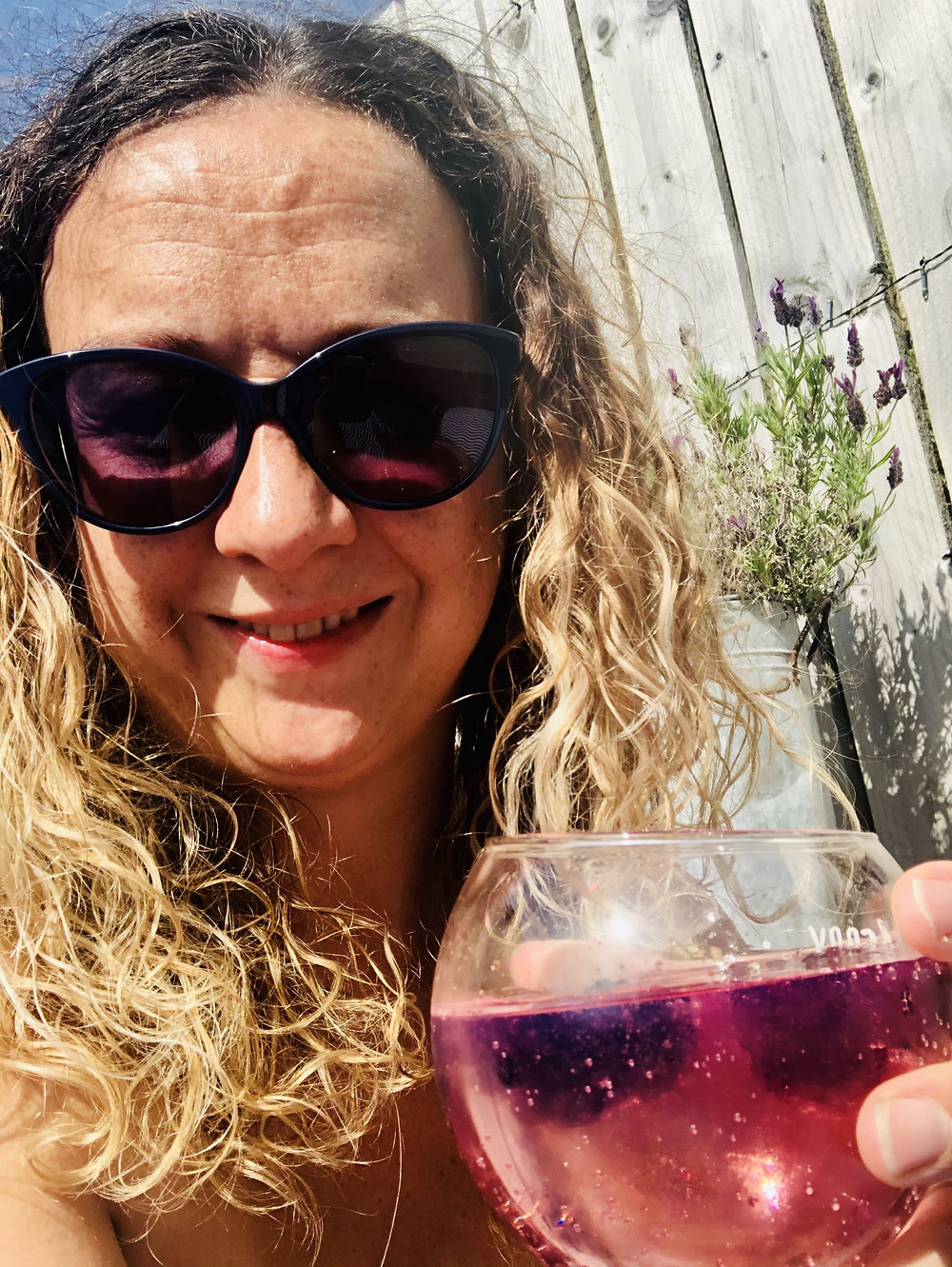 Disabled lockdown holiday at home - wheelchair user Carrie-Ann drinking a cocktail